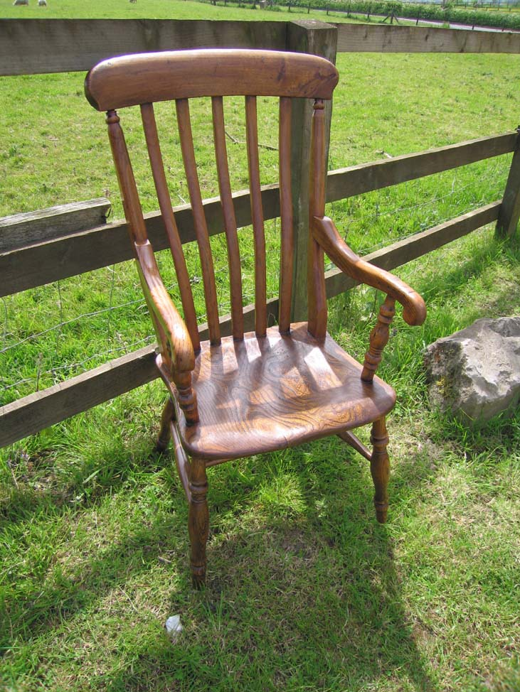 This is a rare little chair. It is an old fruitwood ladder-back nursing  chair. It has a rush seat - that is in really good condition. - The Ministry Of Pine Antique Pine Furniture And Free Standing Kitchens.